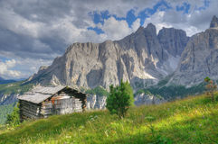 Hut in mountain landscape in the dolomites Stock Image