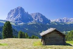 Hut in mountain landscape Stock Photos