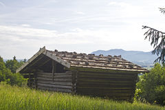 Hut with a mountain meadow Stock Photo