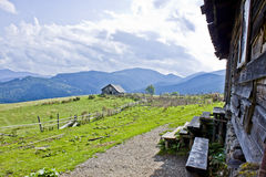 Hut in the mountains. Against the background of clouds Royalty Free Stock Photos