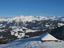 Hut and mountains near Gstaad Royalty Free Stock Photography