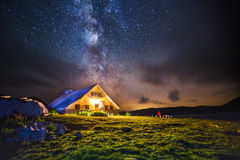 Hut in the mountains at night under the milkyway Stock Images