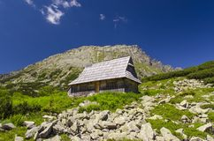 Hut in mountains. Stock Photos