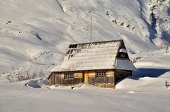Hut in mountains. Hut in snow in polish tatra mountains royalty free stock photography