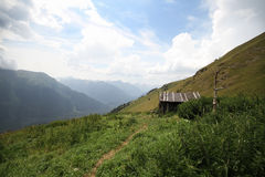 Hut in the mountains Summer landscape. Hut in the mountainsSummer mountain landscape Royalty Free Stock Photo