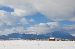 Hut and mountains in winter Royalty Free Stock Photography