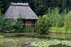 Hut near the lake royalty free stock photography