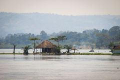 Great african rift in Uganda. Hut on the Nile River. Island on the Nile River. Uganda stock image