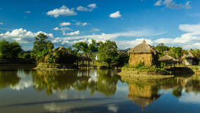 Hut over water. Hut made of straw over water Royalty Free Stock Photos