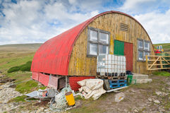 Hut with red corrugated iron roof. Stock Photography