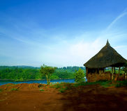 Hut riverside. Riverside hut at twilight in uganda stock image