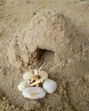 hut of sand on ground. Stock Photo
