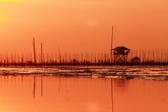 Hut on sea in sunset. Hut silhouette in sunset Royalty Free Stock Image