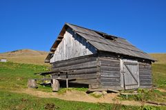 Hut of the shepherd on a hillside. Royalty Free Stock Photography