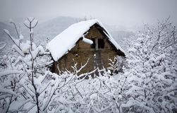 Hut in the snow Stock Photos