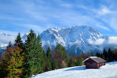 Hut on snow meadow in winter Alps Royalty Free Stock Image