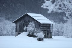 Hut in a snowy scenery Stock Photos