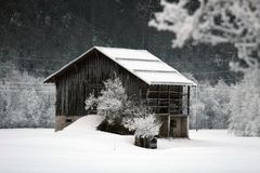 Hut in a snowy scenery Royalty Free Stock Photography