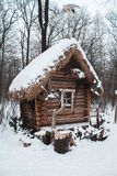 The hut stands in the woods in winter snow Royalty Free Stock Images