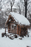 The hut stands in the woods in winter snow Stock Photography