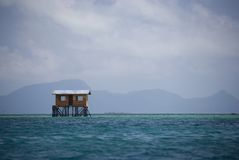 Hut on Stilts in Mid Sea Stock Photos