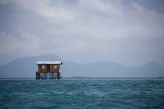 Hut on Stilts in Mid Sea Stock Photos