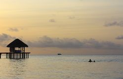 Hut on stilts at sunset in the Maldives Stock Photos