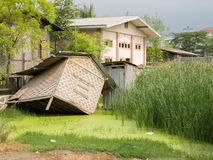 HUT SUBMERGED IN MUD. IN MANDALAY, MYANMAR/BURMA stock image