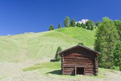 Hut in summer mountain landscape. Royalty Free Stock Image