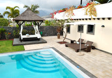 Hut and swimming pool at luxury villa Royalty Free Stock Photos