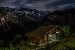 Hut in the Swiss Alps. Night view of a wooden hut in the Swiss mountain village of Gimmelwald, with Mount Eiger in the background Stock Photography