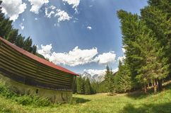 Hut and Trees in the Dolomites Royalty Free Stock Photography