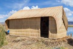 Hut at Uros floating island and village on Lake Titicaca near Puno,  Peru Stock Photography