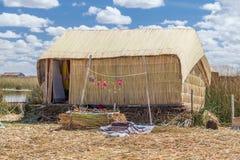 Hut at Uros floating island and village on Lake Titicaca near Puno,  Peru Stock Photo