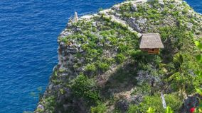 Hut and view point on the cliff edge in the North Coast of Nusa Penida, Bali, Indonesia stock video