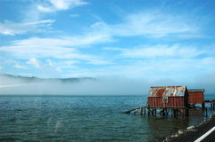Hut on water. A hut on the water in Dunedin peninsula, New Zealand Royalty Free Stock Photos