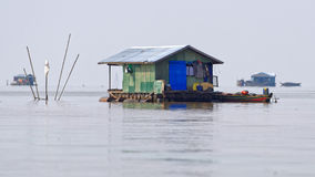 Hut in water, Tonle Sap, Cambodia. Hut on stilts floating in waters of fishing village Tonle Sap in Cambodia Stock Photos