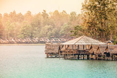 Hut and waterfront village Stock Images