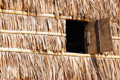 Hut. Window Panel On Thatch Wall Royalty Free Stock Photography