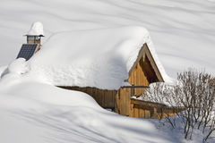 Hut in winter Stock Images
