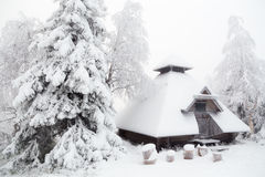 Hut in the winter forest. Snow-covered hut in winter forest. Finnish Lapland Stock Image