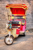 Hutong pedicab. China Peiking Hutong pedicab is a special scenery. The driver are carrying tourists walking in the Hutong and telling stories about the history Stock Image