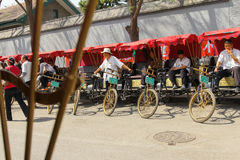 Hutong tricycle rider Stock Photo