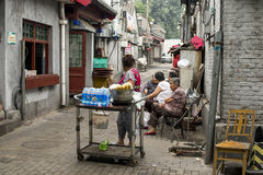 Hutongs peddler and old people Royalty Free Stock Image