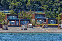Huts at the beach of luxury hotel Royalty Free Stock Image
