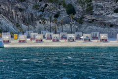 Huts at the beach of luxury hotel Stock Photos
