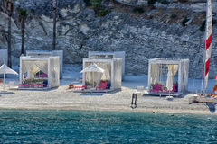 Huts at the beach of luxury hotel Royalty Free Stock Photo