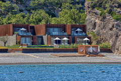 Huts at the beach of luxury hotel Stock Photo