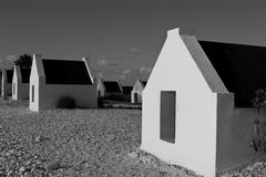 Huts in Black and White. Small huts with single windows in black and white. Location Caribbean Bonaire Stock Image