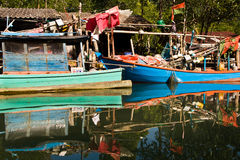 Huts and colorful  fisherboats at Royalty Free Stock Photography